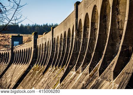The Architecture Of Clatteringshaws Dam, With Arches Along The Top Of The Curved Dam, Galloay Hydro
