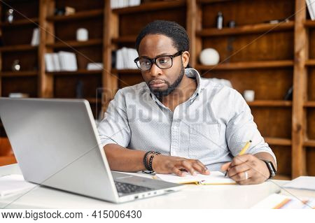 Business Planning, E-learning Concept, Casual African American Business Man Writing On Notebook And