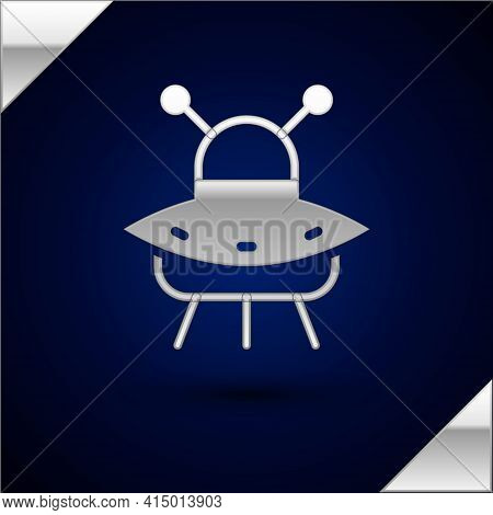 Silver Ufo Flying Spaceship Icon Isolated On Dark Blue Background. Flying Saucer. Alien Space Ship.