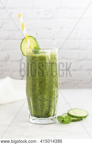 Green Smoothie Glass Made With Spinach, Banana Blueberry, Cucumber, Avocado, Bright Kitchen Backgrou