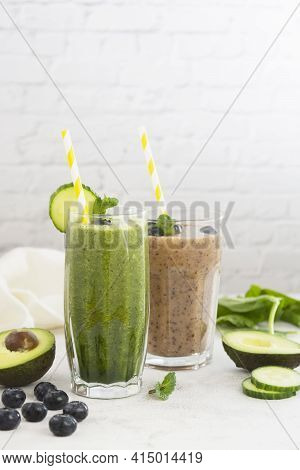 Healthy Drinks Food. Fresh Pink And Green Smoothie. Spinach Smoothie With Cucumber And Banana Smooth