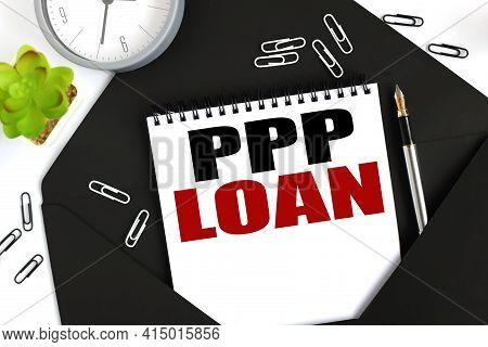 Paycheck Protection Program Ppp Loan. Text On A Sheet Of Notepad On A Black Envelope On A Light Back