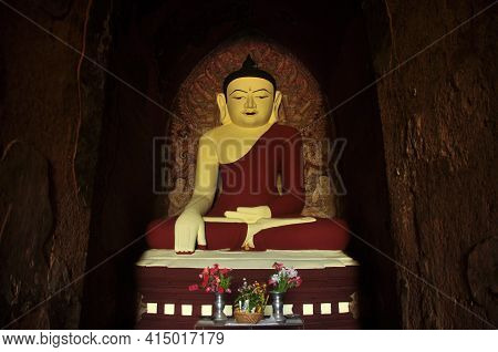 Bagan, Myanmar - November 18, 2015: Huge Colored Statue Of Buddha In Temple, From Below Shot Of Colo