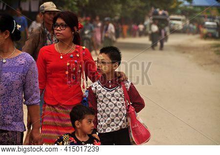 Bagan, Myanmar - November 18, 2015 Adult Ethnic Woman With Children In Big Family Walking On Street,