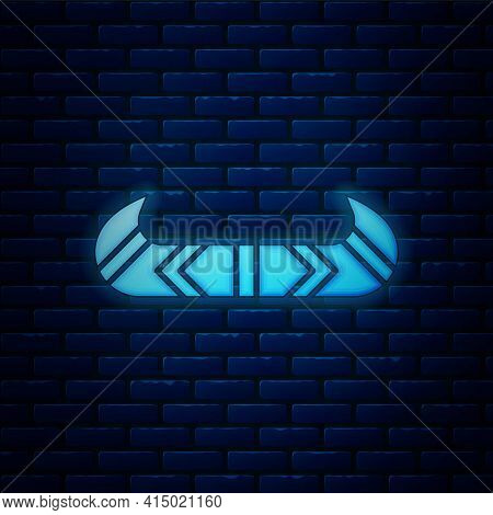 Glowing Neon Kayak And Paddle Icon Isolated On Brick Wall Background. Kayak And Canoe For Fishing An