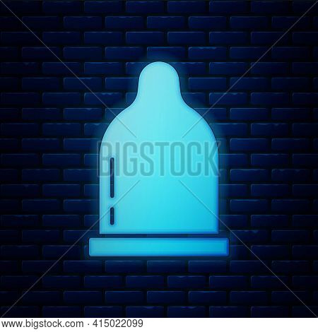 Glowing Neon Condom Icon Isolated On Brick Wall Background. Safe Love Symbol. Contraceptive Method F