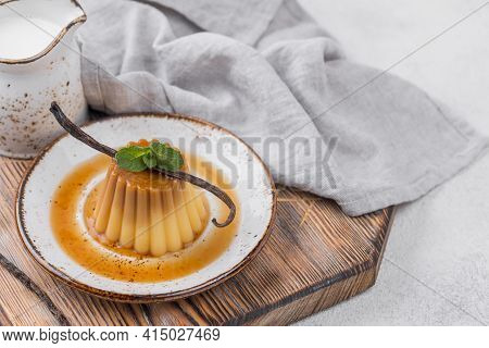 Custard Plate With Mint Vanilla Pod. High Quality And Resolution Beautiful Photo Concept