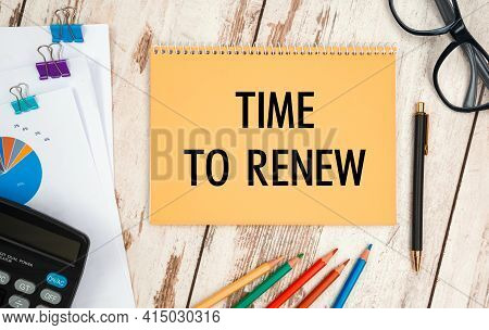 Notebook With Text - Time To Renew, On The Office Table, Documents, Calculator, Glasses And Pen