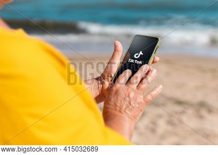 Podolsk, Ukraine - March 29, 2021: Close-up Of Woman Holding A Iphone X With Social Internet Service