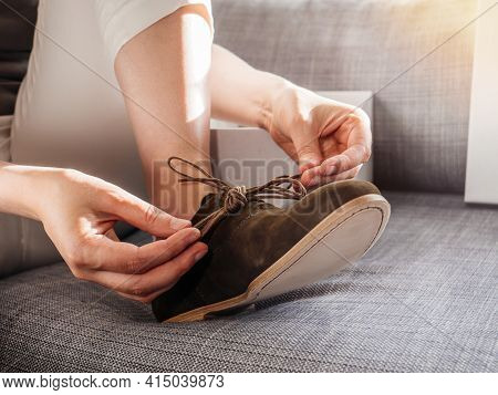 Woman Tying Laces On New Nubuck Luxury Leather Shoes With Genuine Italian Leather Sole