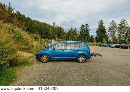 Mummelsee, Germany - Sep 22, 2018: Side View At The Lava Blue Colored Volkswagen Touran Van With Bik