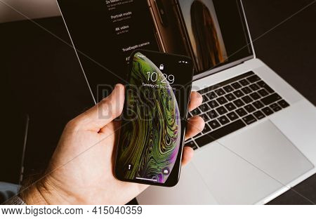 Paris, France - Sep 25, 2018: Pov Male Hand Holding Latest Apple Computers Iphone Smartphone Xs Max