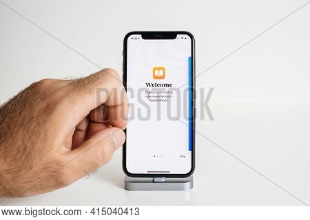 Paris, France - Sep 25, 2018: Pov Male Hand Preparing To Touch The Isolated On White Latest Apple Co
