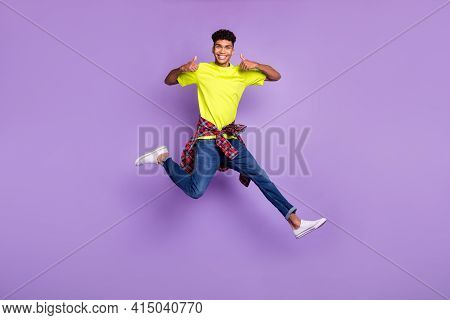 Full Size Photo Of Young Black Man Happy Positive Smile Jump Show Thumb-up Like Cool Advert Isolated