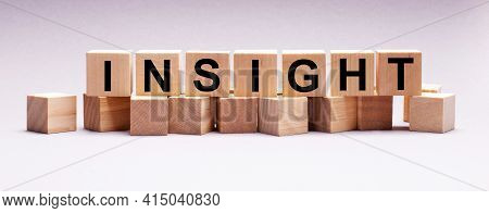 On A Light Background, Wooden Cubes With The Text Insight
