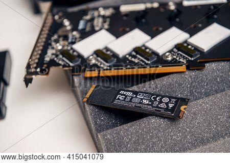 Paris, France - Dec 20, 2020: New Nvme Ssd Fast Computer Disk Near Nvme Raid Device Pcie Card