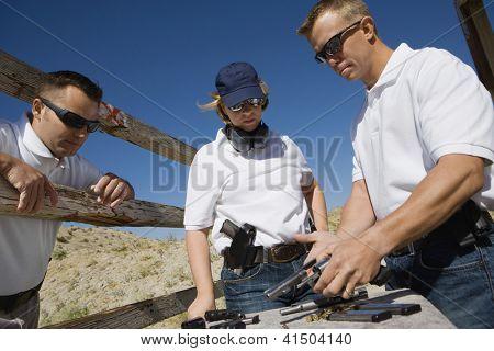 Troops reloading pistols at shooting range