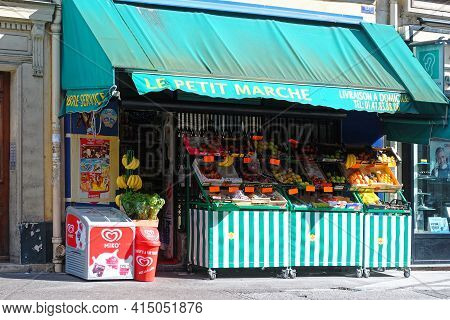 Paris, France, June 21: A Mini Grocery Store Selling Vegetables On Vaugirard Street In The Early Mor