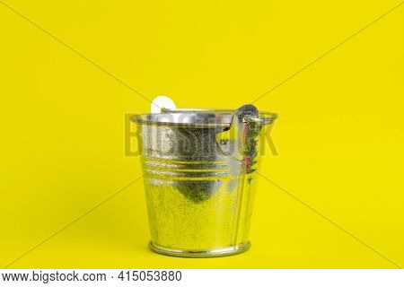 Empty Metal Bucket On A Yellow Background Close-up.