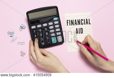 Keyboard Of Laptop, Calcualtor, Pencil And Notepad With Text Financial Aid On The White Background