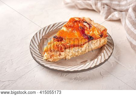 Piece Of Homemade Quiche Pie With Chicken, Dried Tomatoes, Cheddar Cheese On Ceramic Plate