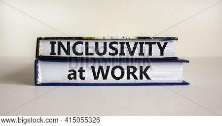 Inclusivity At Work Symbol. Books With Words 'inclusivity At Work' On Beautiful White Background. Bu