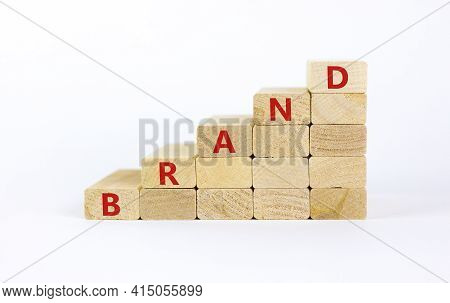 Brand Symbol. Concept Word 'brand' On Wooden Cubes On A Beautiful White Table. White Background. Bus