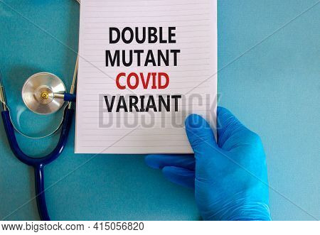 Covid-19 Double Mutant Symbol. Doctor Hand In Blue Glove With White Card. Concept Words 'double Muta