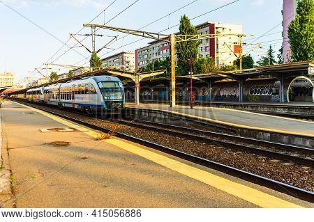 Detail Of Train In Motion At Train Platform At Bucharest North Railway Station (gara De Nord Buchare