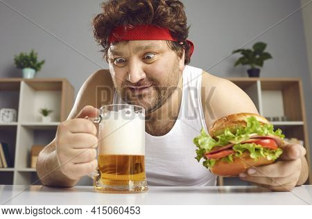 Excited Crazy Fat Man Drinking Beer And Eating Burger Headshot Portrait