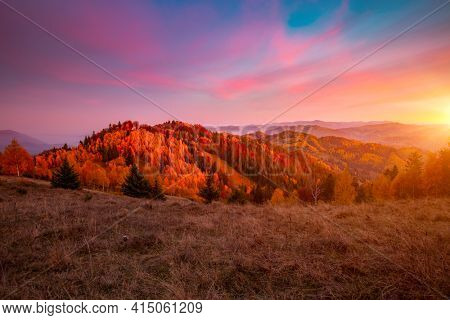 Splendid autumn scene of a rolling hills at sunset. Mountains in morning light. Location place Carpathian, Ukraine, Europe. Wild protected area. Vibrant photo wallpaper. Discover the beauty of earth.