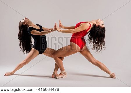 The Two Modern Ballet Dancers In Black And Red Bodysuit, Studio