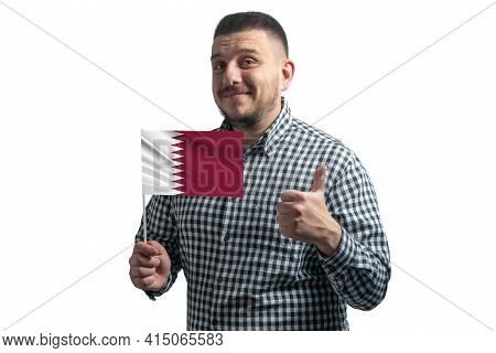 White Guy Holding A Flag Of Qatar And Shows The Class By Hand Isolated On A White Background. Like F