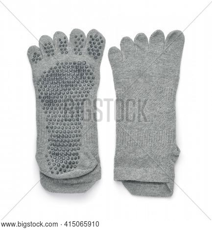 Top view of gray non-slip yoga toe socks isolated on white