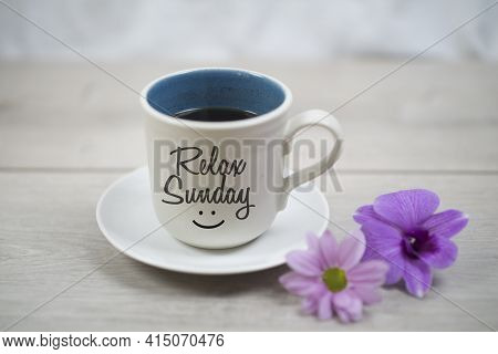 Relax Sunday. Sunday Concept With Happy Smile On Cup Of Morning Coffee Closeup, Purple Daisy Orchid