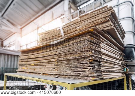Stack Prepared Pile Of Used Compressed Corrugated Cardboard And Waste Paper Wrap Collected For Recyc