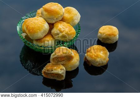 A Traditional Asian Pastry Or Tao Sor On Black Background. Chinese Sweet Pastry Filled With Mung Bea