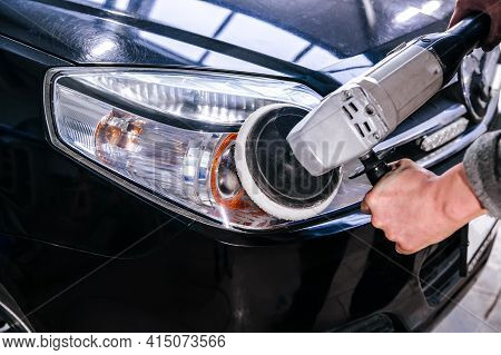 Car Headlight Cleaning Polishing Machine At Car Service At Shallow Depth Of Field