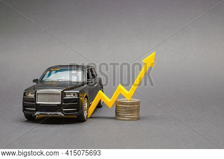 Rising Car Prices. On A Black Background, There Is A Model Car With A Yellow Arrow Pointing Upwards.