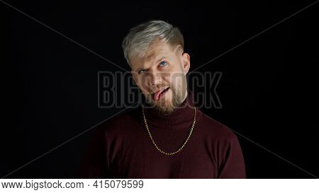 Comical Stupid Stylish Man With Blue Eyes In Trendy Clothes Making Funny Awkward Silly Face Grimace,