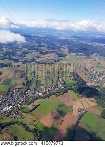 Luscious Green Fields And Parcels Of Land Of A Community As Seen From Up Above