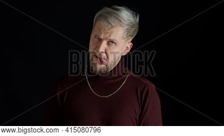 Stupid Comical Stylish Man With Blue Eyes In Trendy Clothes Making Funny Awkward Silly Face Grimace,