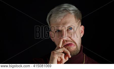 Funny Stupid Smiling Stylish Young Man With Blue Eyes Picking Nose With Silly Smiling Humorous Expre