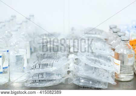 Moscow. Russia. March 11, 2021. A Large Pile Of Intravenous Saline Bags In The Hospital On The Table