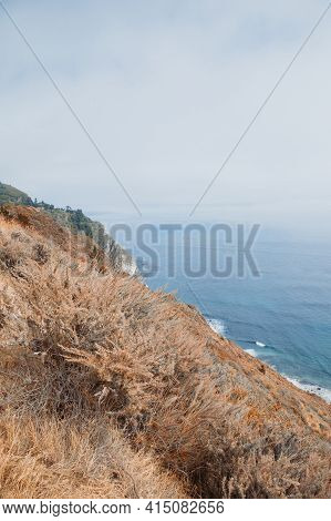 Beautiful Landscape Near Monterey City In California. Turquoise Ocean With Big Waves And Rocky Cliff