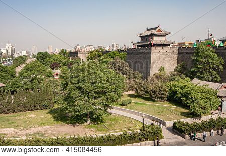 Xian, China - April 30, 2010: Huancheng City Wall. Small Square Stand Out Of Wall With Tower Buildin