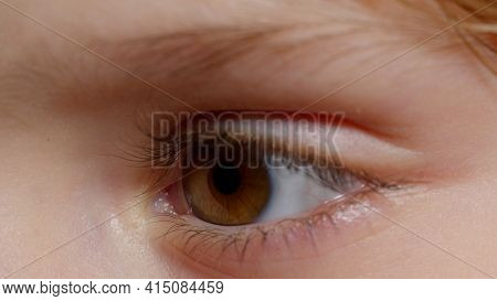 Highly Detailed Macro Shot Opening, Closing Brown Color Pigmentation Eyes Of Little Girl. Slow Motio