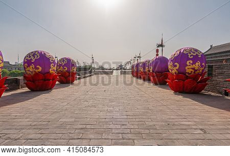 Xian, China - April 30, 2010: Huancheng City Wall. Year Of The Tiger Display. Tows Of Gold-purple In