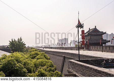 Xian, China - April 30, 2010: Huancheng City Wall. Long Shot Over Wide Brown-stone Rampart Top Under