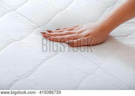 Female Hand Pressing Testing Mattress To Check Softness. Choice Comfortable Mattress For Sleep In St